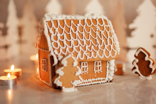 Gingerbread house on the table in a bright living room Premium Photo