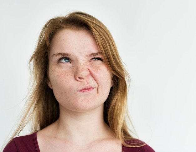 Girl annoyed face expression portrait Premium Photo