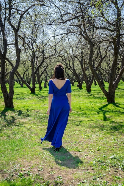Girl in an apple orchard Premium Photo