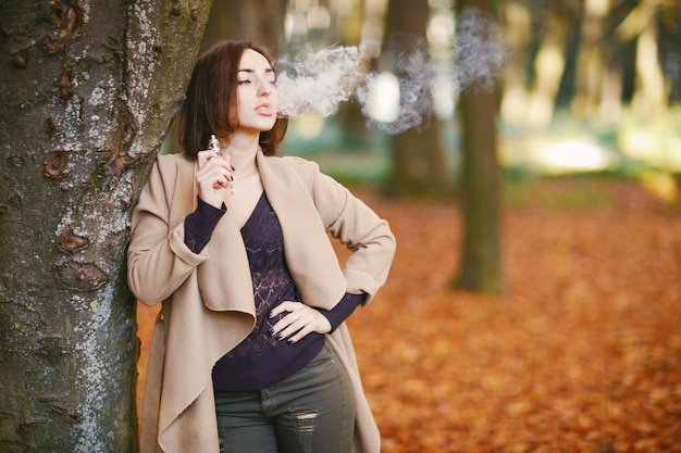 Girl in the autumn park Free Photo