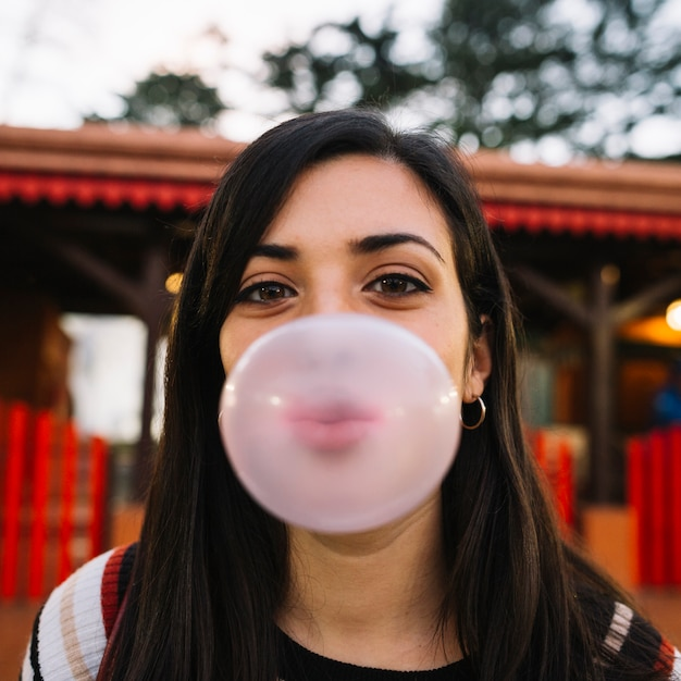 Girl blowing chewing gum Free Photo