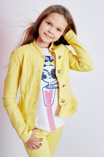 Girl bright summer look beautiful clothes. Premium Photo