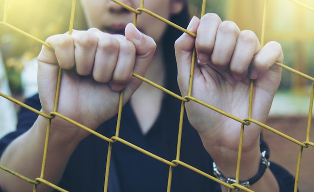 Girl and cage Free Photo