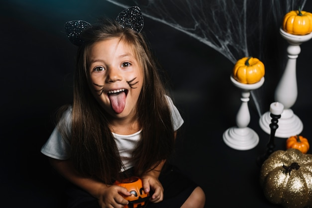 Girl in cat costume showing tongue Free Photo
