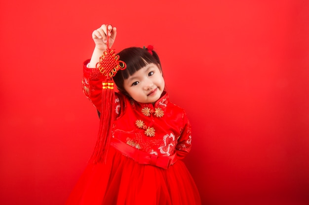 A girl celebrates chinese new year with a chinese knot Premium Photo