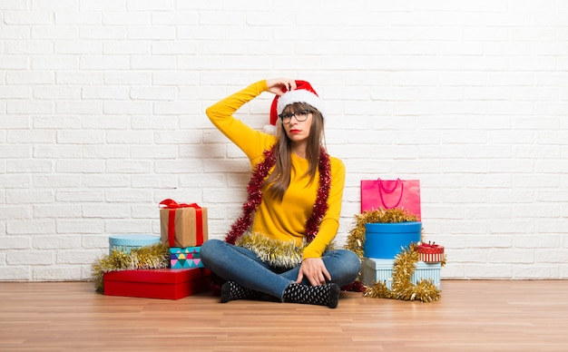 Girl celebrating the christmas holidays standing and thinking an idea Premium Photo