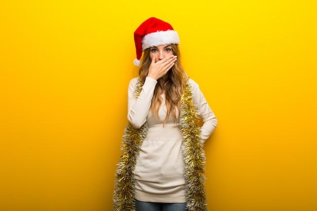 Girl celebrating the christmas holidays on yellow background Premium Photo