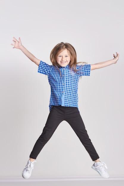 Girl child having fun and posing in studio Premium Photo