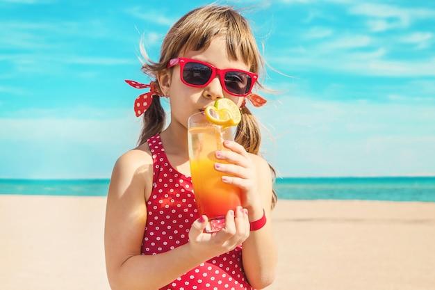 Girl child resting on the sea. selective focus. Premium Photo