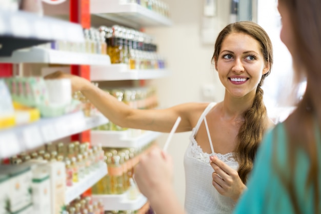 girl chooses perfume in the shop Premium Photo