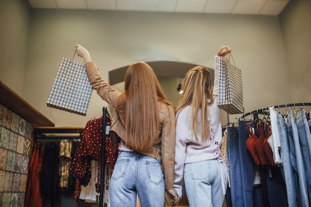 Girl choosing clothes in the store Premium Photo