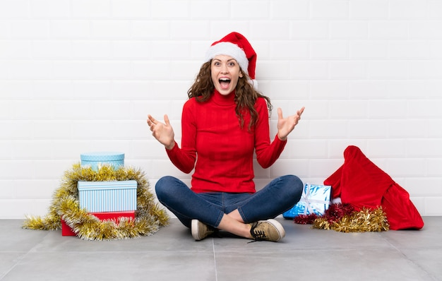 Girl in christmas holidays sitting on the floor unhappy and frustrated with something Premium Photo