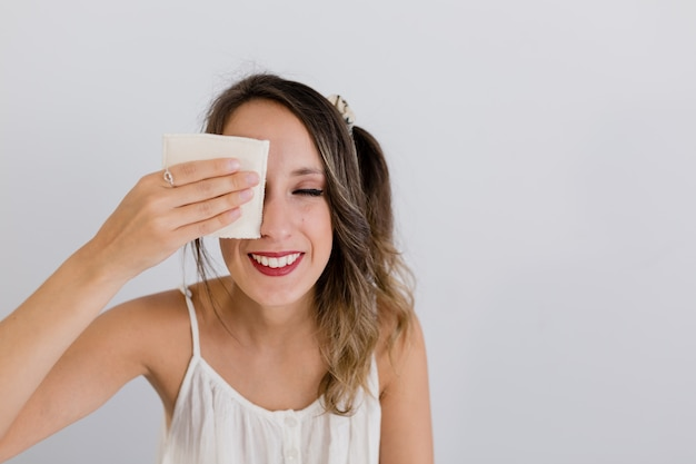 Girl cleans her skin with a cloth pad Premium Photo