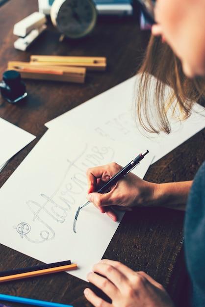 Girl creating a typography illustration Premium Photo