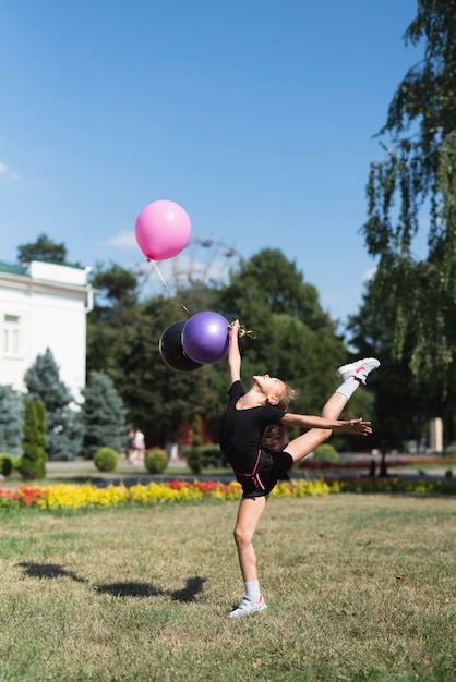Girl doing gymnastics with balloons Free Photo