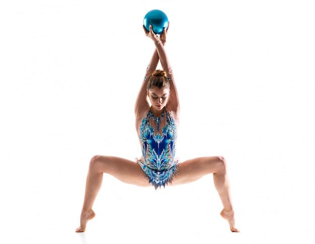 Girl doing rhythmic gymnastics with ball Premium Photo
