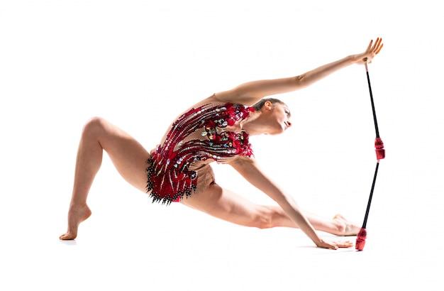 Girl doing rhythmic gymnastics with maces Premium Photo