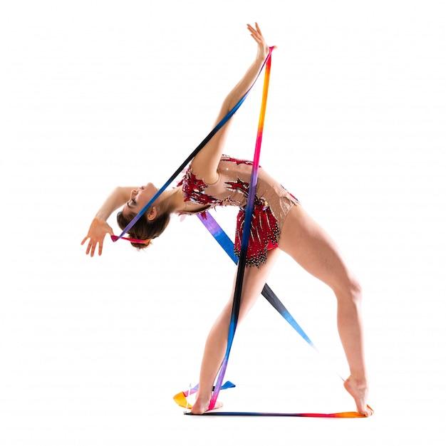 Girl doing rhythmic gymnastics with ribbon Premium Photo