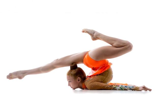 Girl doing rhythmic gymnastics Free Photo
