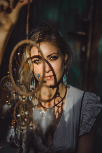 Girl and dream catcher Free Photo
