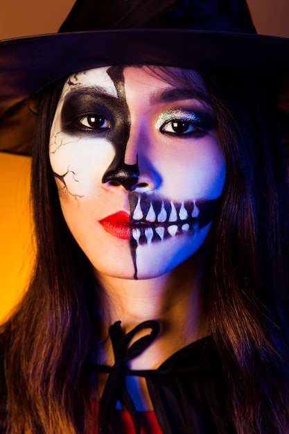 Girl dressed as vampire and wearing mask Free Photo