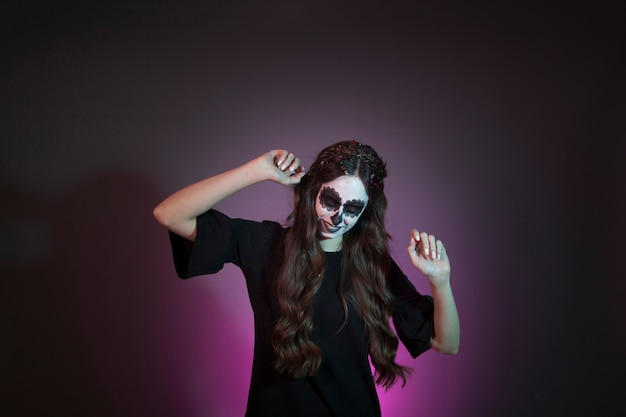 Girl dressed as witch is dancing Free Photo