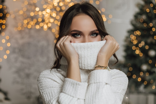 Girl dressed a pullover on her face Free Photo