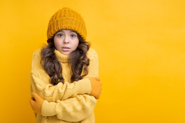 Girl dressed in yellow with crossed hands Free Photo