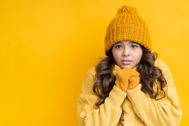 Girl dressed in yellow on a yellow background Free Photo