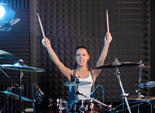 Girl behind drum-type installation in a professional studio. Premium Photo