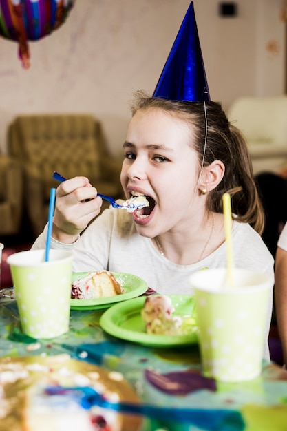 Girl Eating Cake On Birthday Party Photo Free Download