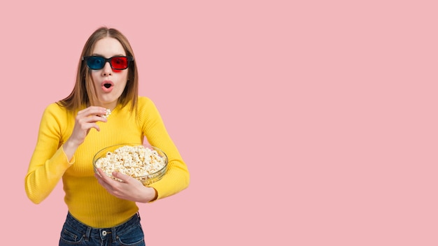 Girl eating popcorn Free Photo