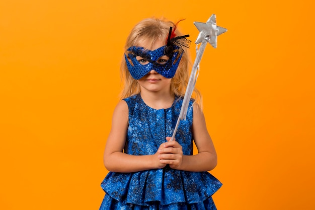 Girl in fairy costume with mask and wand Free Photo