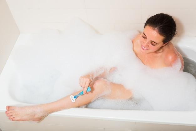 Girl in foam at bathtub Free Photo
