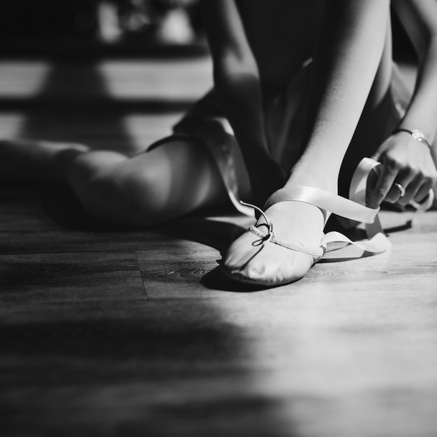 A girl getting ready to for a ballet lesson Free Photo