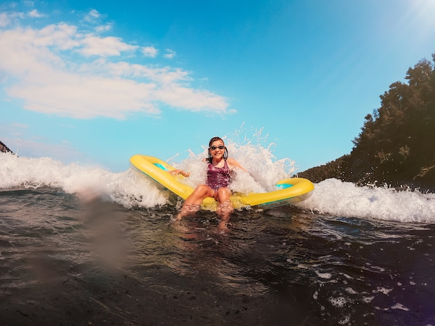Girl getting splashed by the big waves Premium Photo