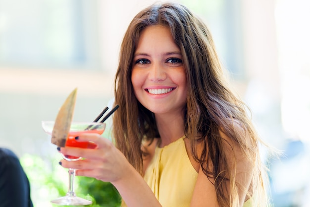 Girl having a cocktail in a pub Premium Photo