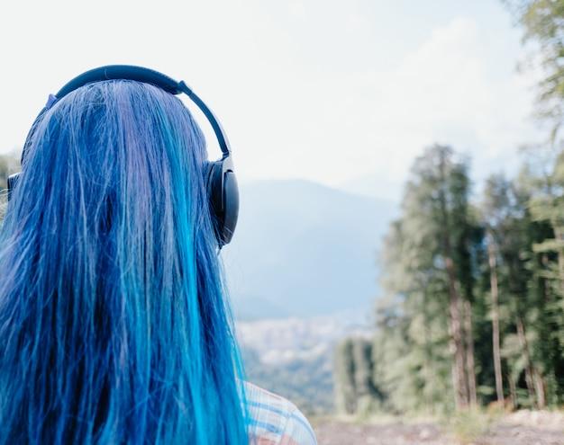 Girl in headphones outdoor. Premium Photo