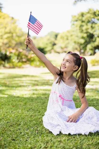Girl holding an american flag Premium Photo