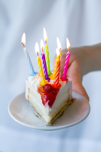 Girl Holding Beautiful Appetizing Birthday Cake With Many Candles