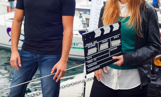 Girl holding clapperboard Premium Photo