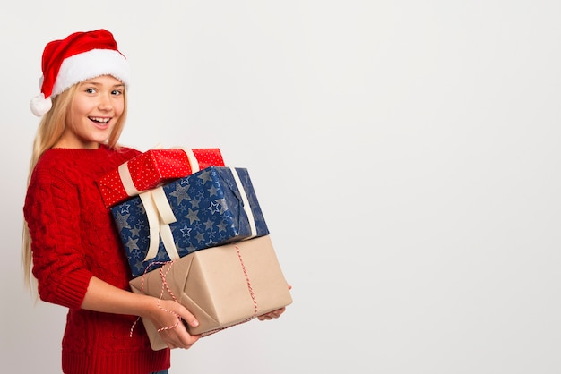 Girl holding pile of presents Free Photo