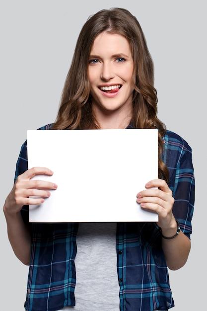 Girl holding white billboard Free Photo