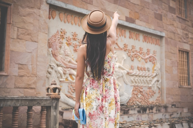 Girl holds a tourist map in the old town  Photo | Free Download