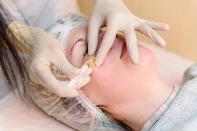 Girl, injections, cosmetology Premium Photo