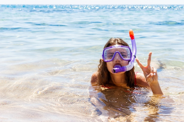 Girl is engaged in scuba diving in a clean clear sea. Premium Photo