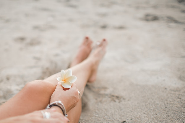 The girl is sitting on the beach Free Photo