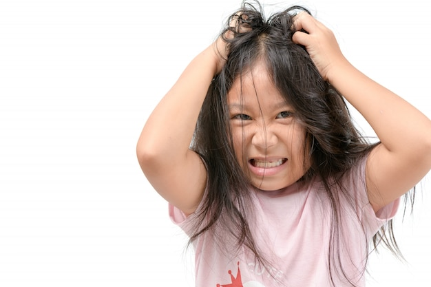Girl itchy his hair or frustrated and angry kid Premium Photo
