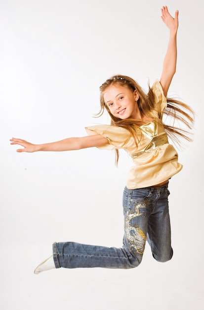 Girl jumps on a white background Premium Photo