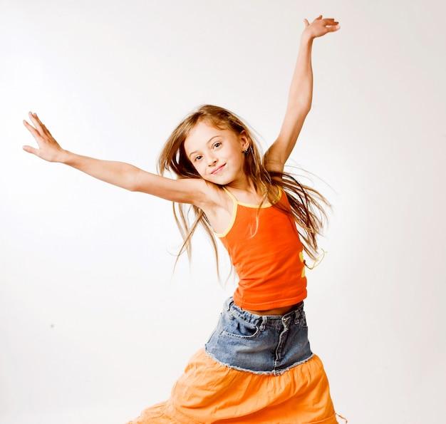 Girl jumps on white Premium Photo
